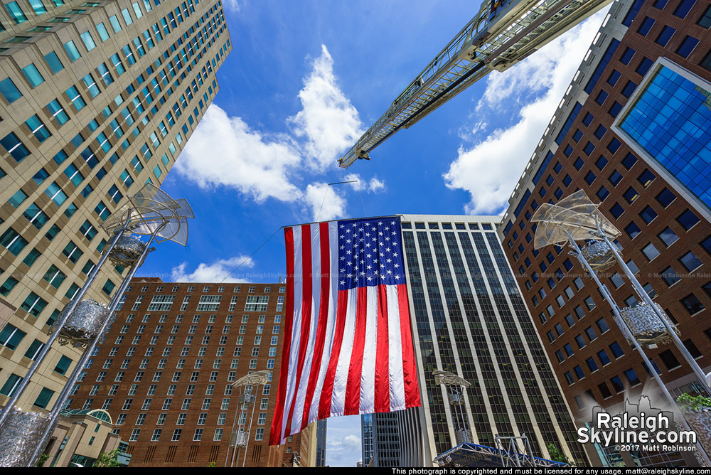 Large American flag over City Plaza and downtown Raleigh on July 4th