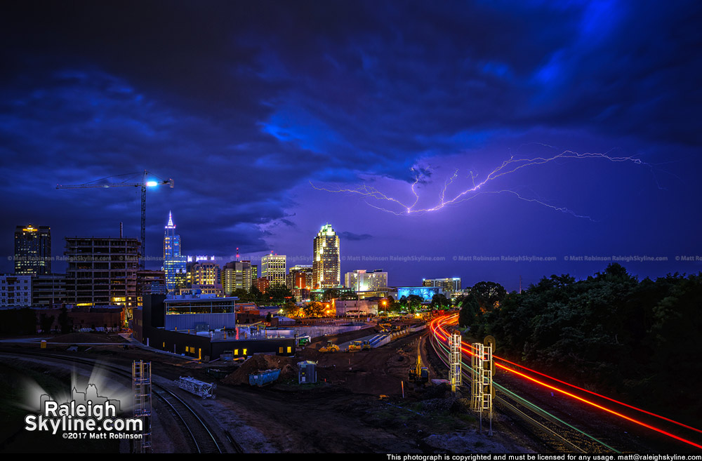 Lightning lights up the sky over Raleigh as Amtrak Piedmont pulls into its last stop for the day.