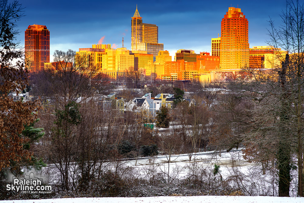 Sun illuminates the Raleigh Skyline from Dorothea Dix after snow