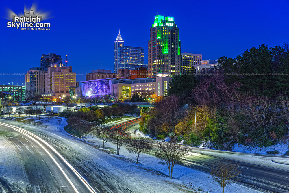Blue hour downtown Raleigh skyline with snowy roads