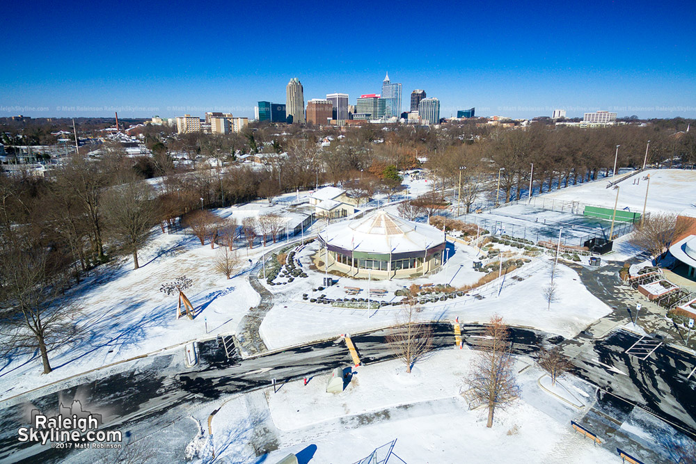 Chavis Park aerial during after the snow with downtown Raleigh