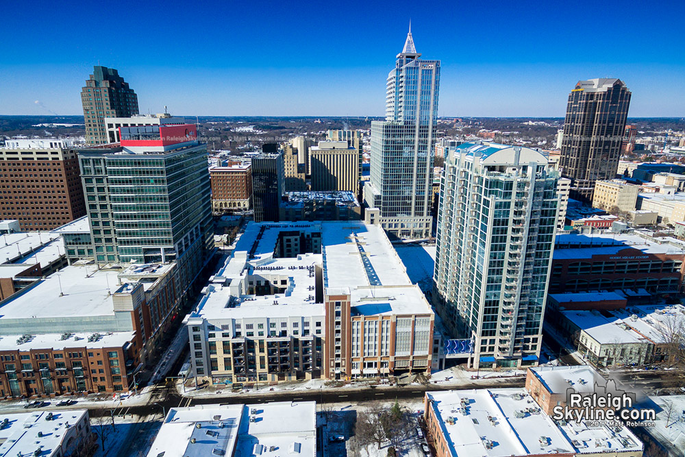 Sunny blue sky with downtown Raleigh after the snowfall