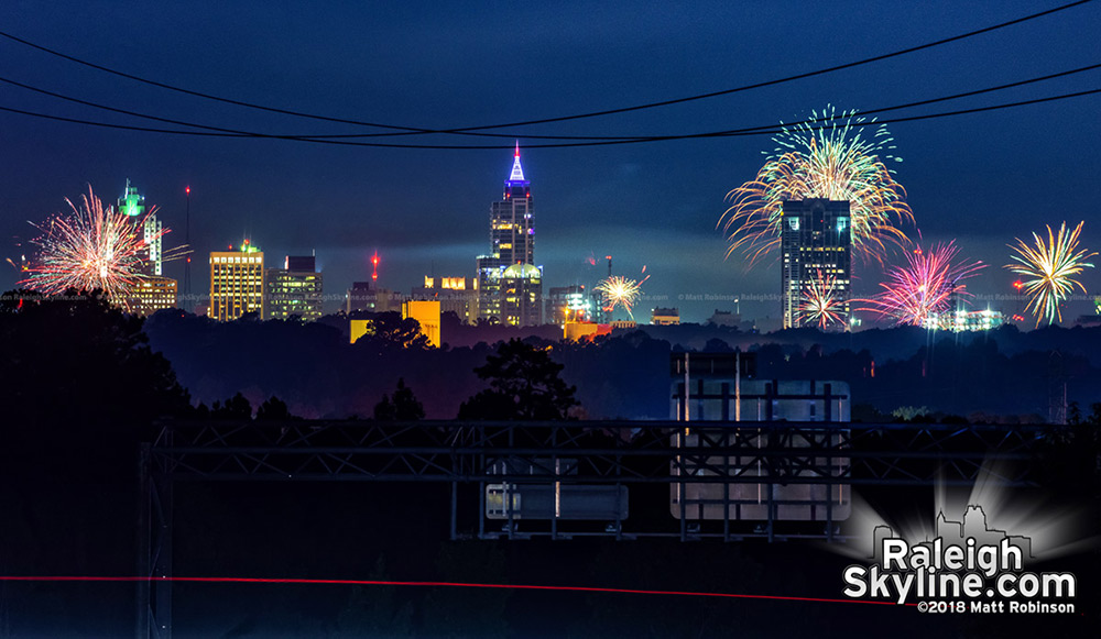 July 4th fireworks exploding all over Raleigh as seen from Knightdale