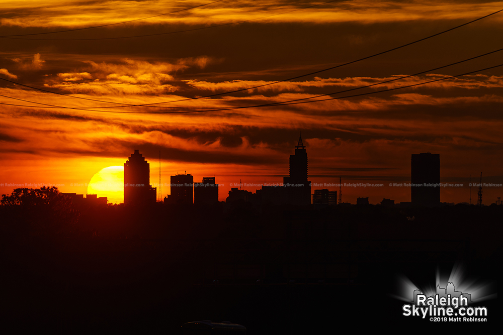 View of sunset behind Raleigh from over 6.5 miles away (near Knightdale)