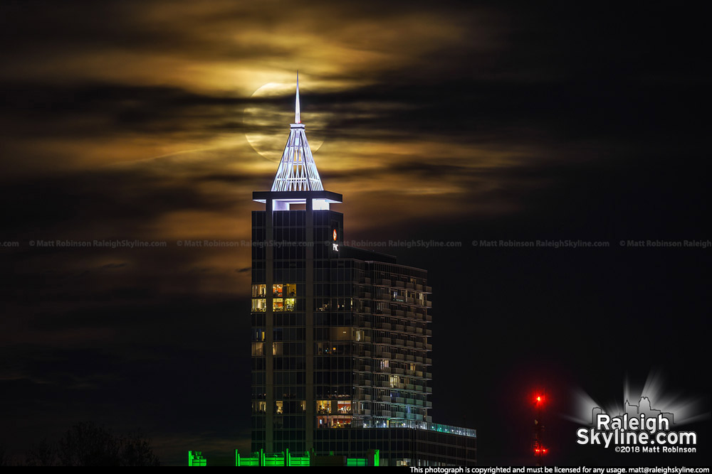 Cloudy moonrise behind Raleigh