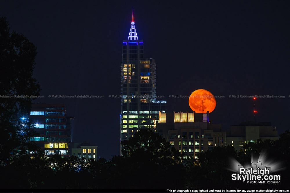Orange moon behind Raleigh