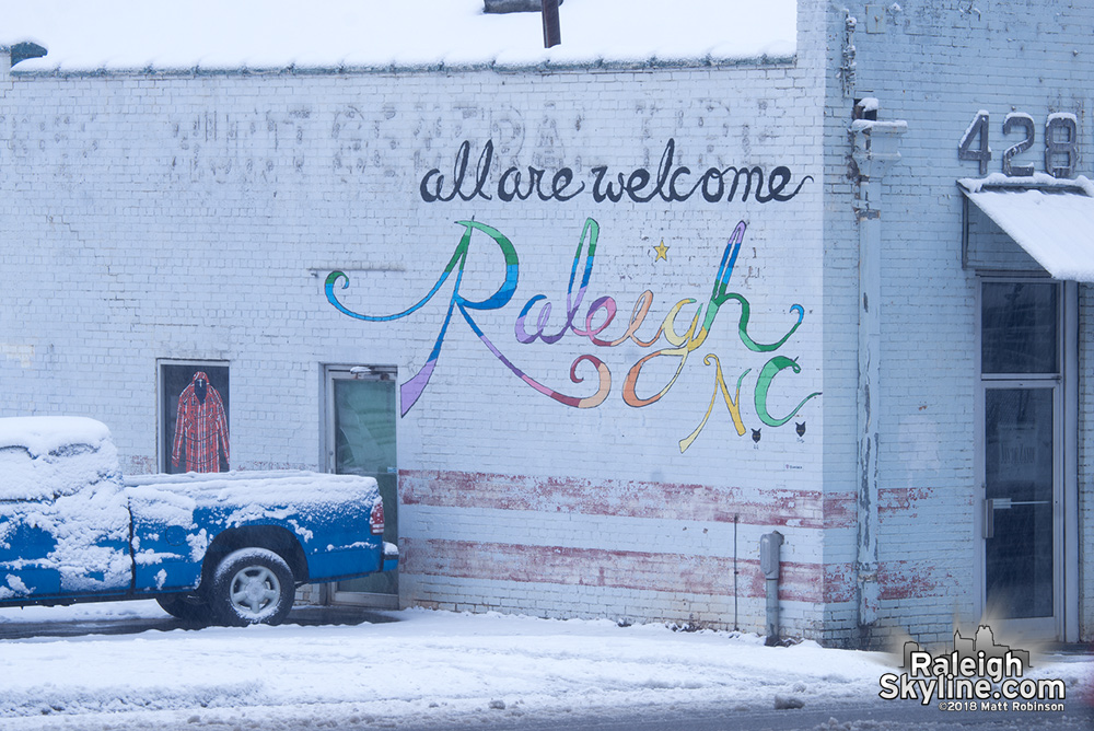 Raleigh All are Welcome sign in the snow
