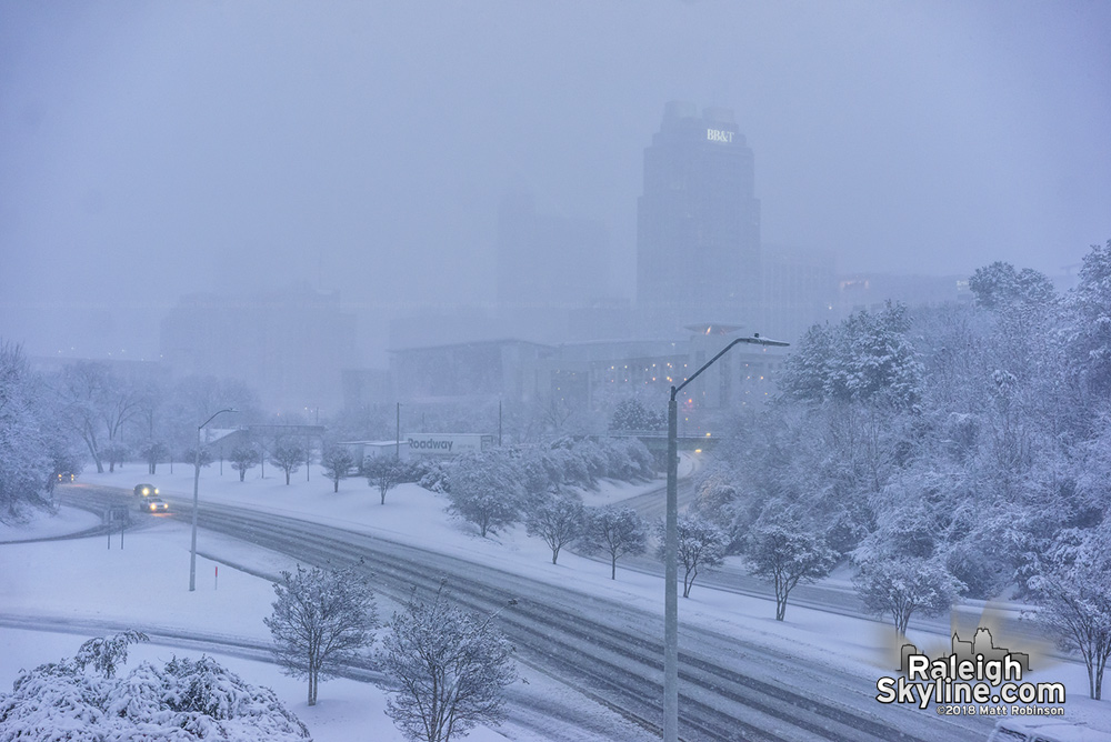 Snow begins to taper of as downtown slowy emerges