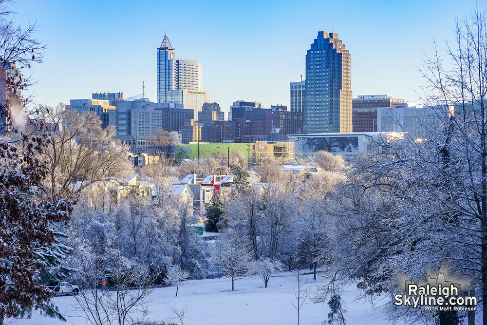 Downtown Raleigh and snow with Clear skies on January 18, 2018
