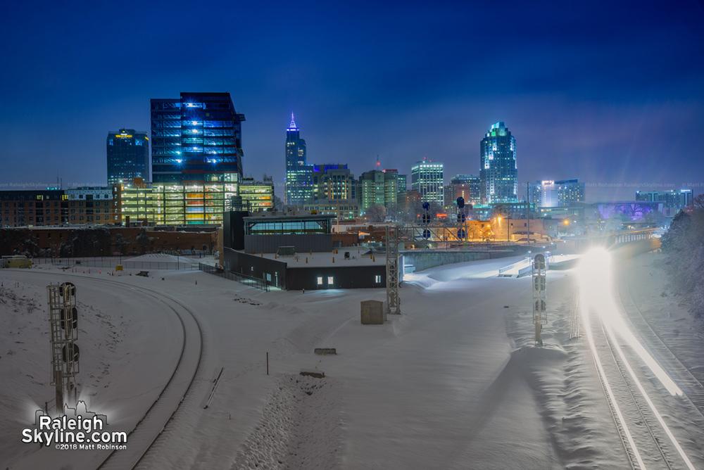 A lone train cuts through the snowy silence from Boylan Avenue.