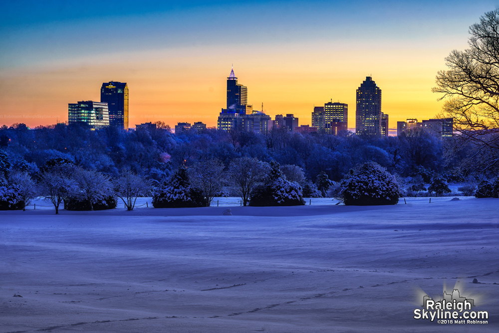 The Raleigh skyline before sunrise this morning from Dorothea Dix Park. 15 degrees with a little over 6 inches of snow on the ground