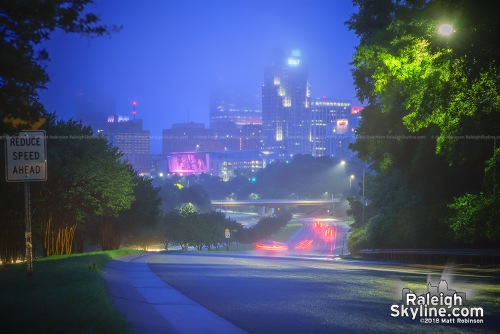 Downtown Raleigh fades into low rain clouds