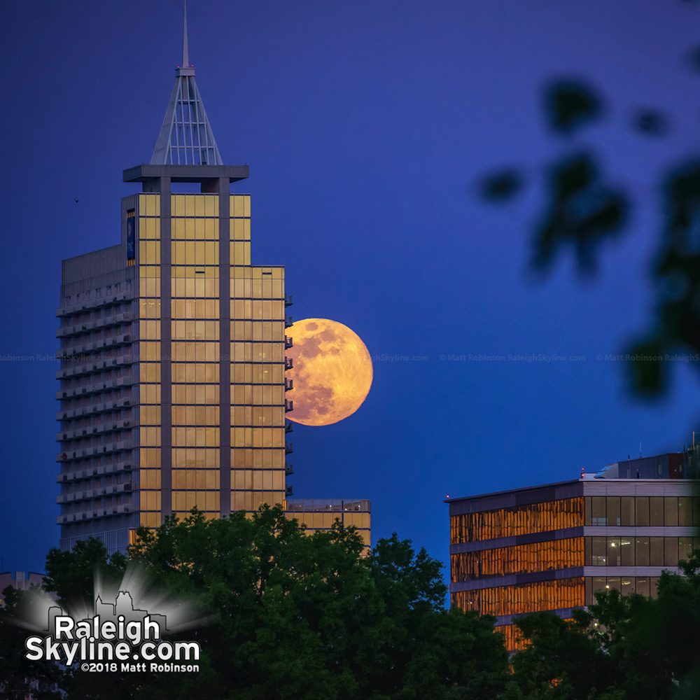 Full moon rises behind PNC Plaza