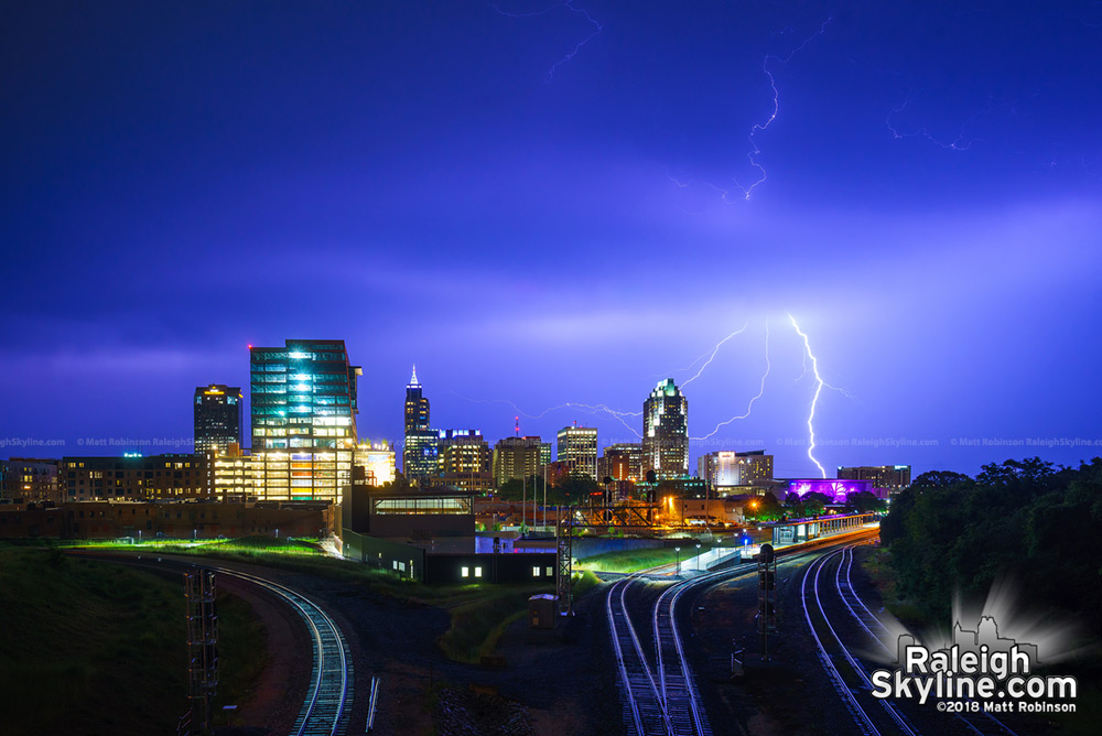 Lightning strikes behind the Raleigh skyline