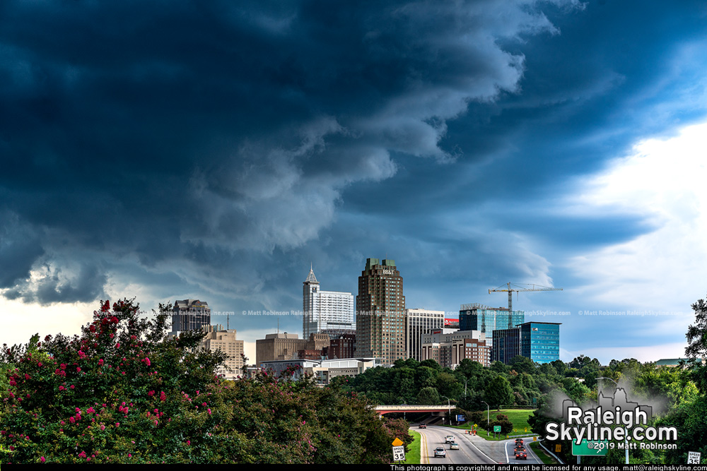 Dramatic clouds behind downtown Raleigh