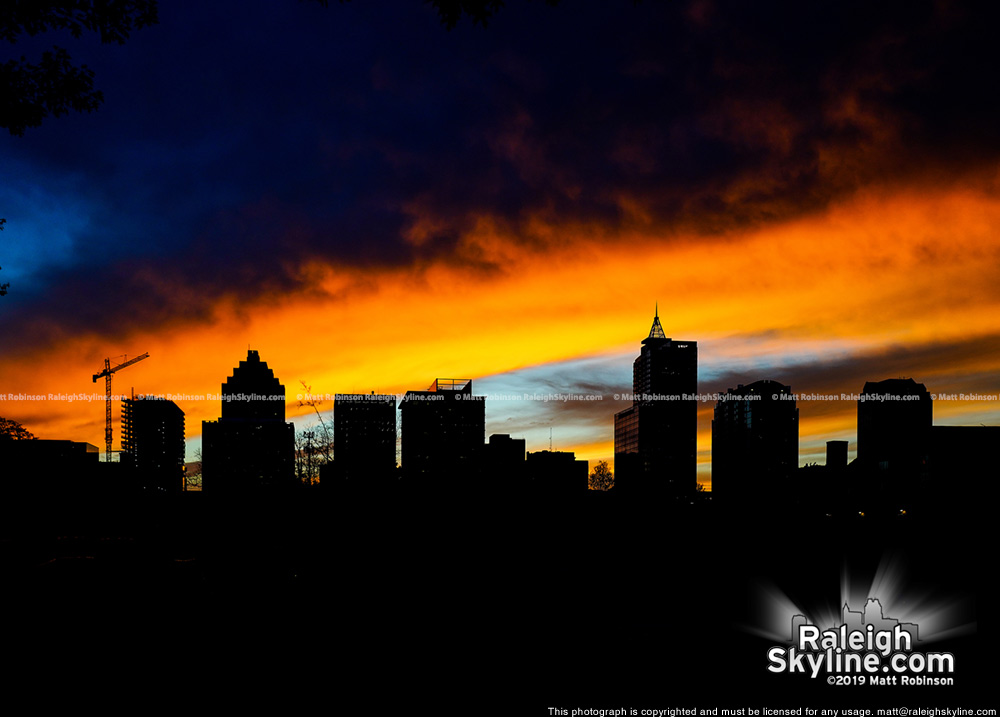 Vivid sunset with silhouetted Raleigh Skyline