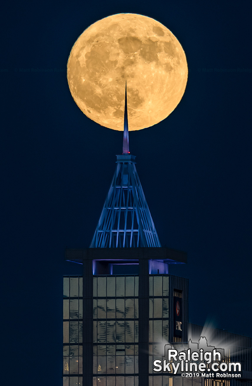 Spire of PNC Plaza pokes the full moon rising