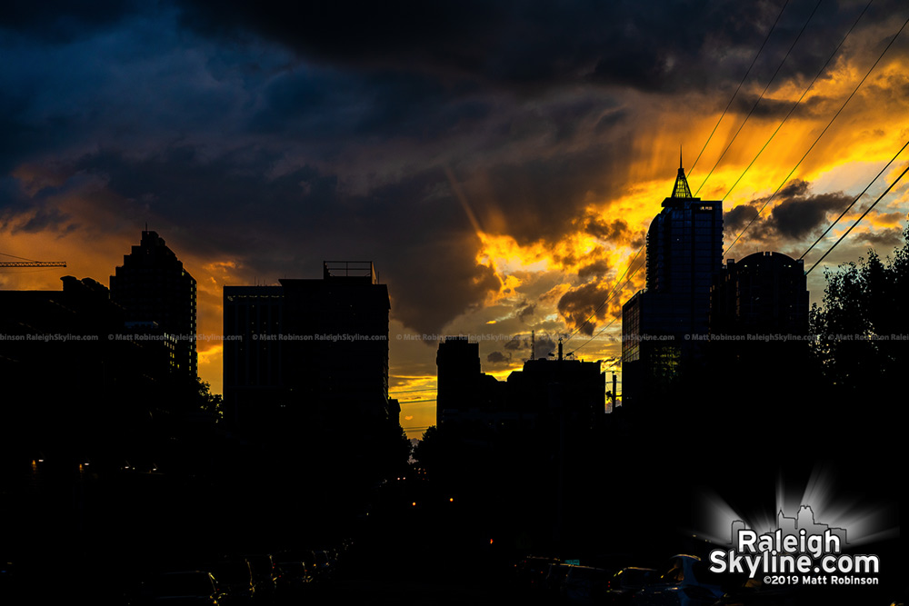 Sun rays burst behind Raleigh