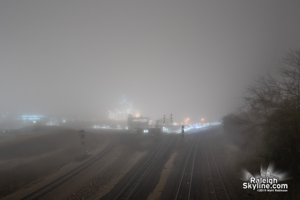 Fog completely obscures downtown Raleigh from Boylan Avenue