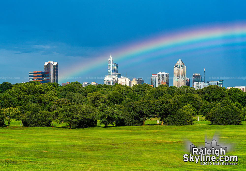 Low slung Supernumerary Rainbows over the downtown Raleigh skyline from Dorothea Dix Park