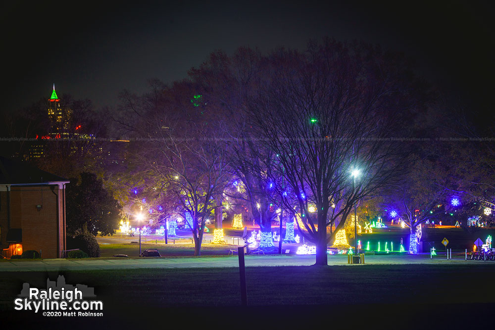 Christmas lights at Dix Park with downtown Raleigh