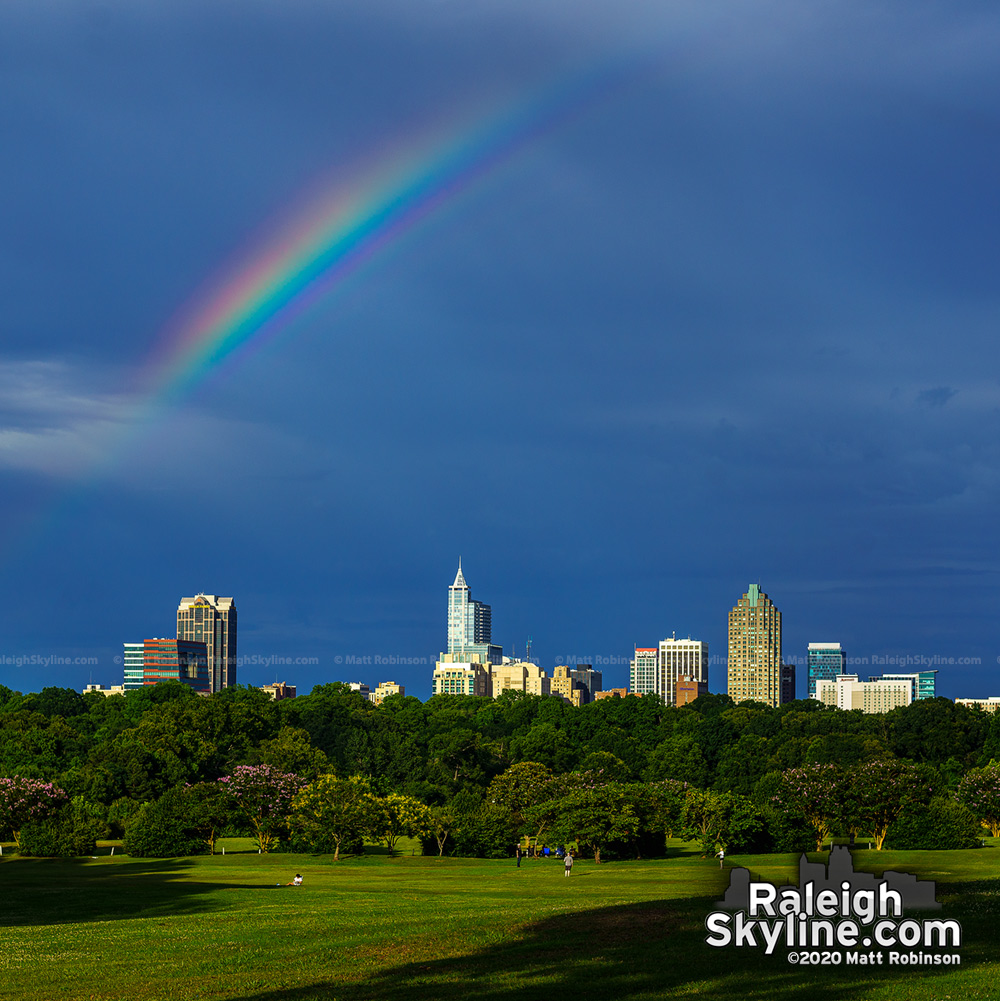 A partial rainbow streaks above Raleigh from Dix Park