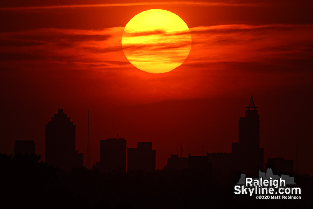 Disc of the Sun aligning over Raleigh from 7 miles away