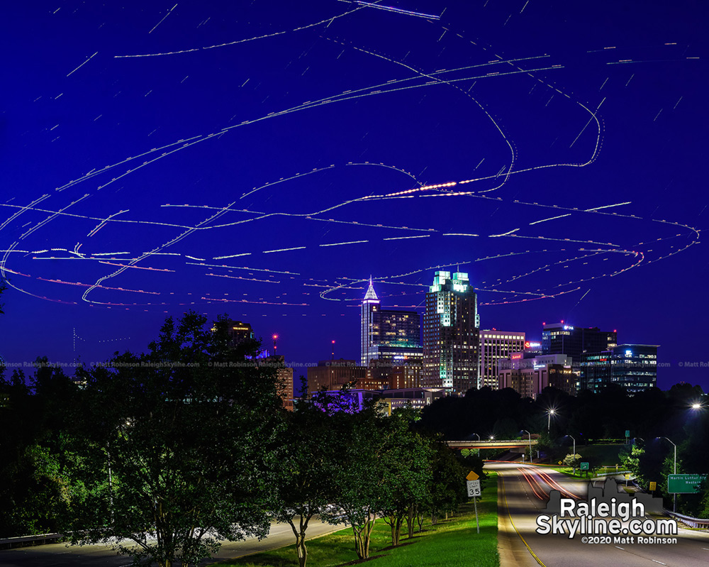3 helicopters circle over downtown Raleigh
