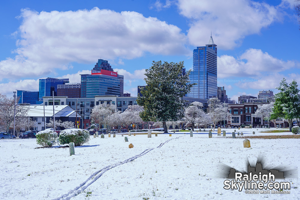 Raleigh City cemetery view of the skyline in the snow