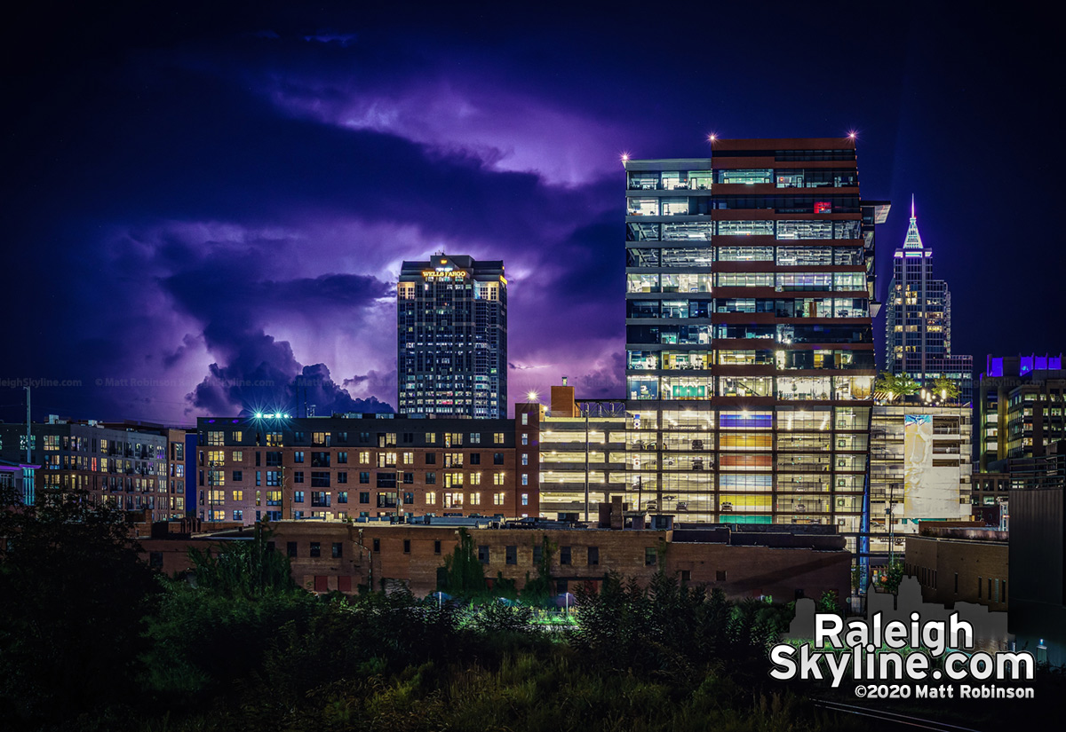 A thunderstorm over 40 miles away lights up the horizon behind downtown Raleigh