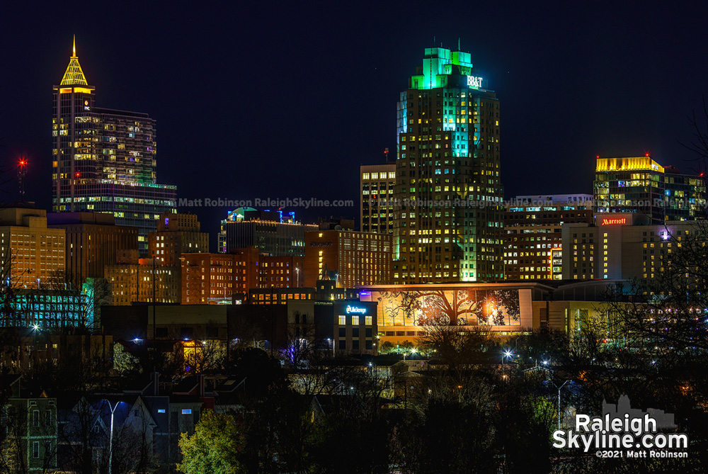 Downtown Raleigh buildings illuminated amber to remember the lives lost to Covid-19