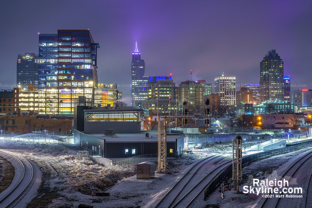 Snow accumulation with downtown Raleigh from Boylan Bridge