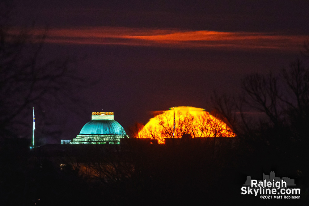 The mooon rising adjacent to the North Carolina State Capitol dome (with even a bit of a lunar green flash visible).