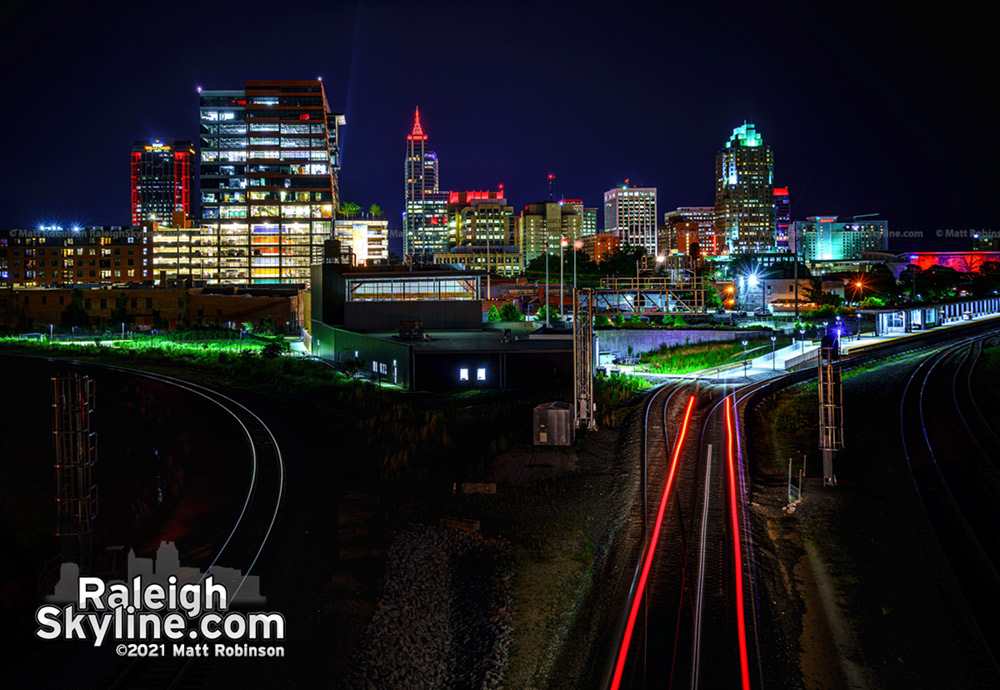 The red lights of an NCDOT locomotive add to the red-lit skyline of downtown Raleigh in support of the Carolina Hurricanes.